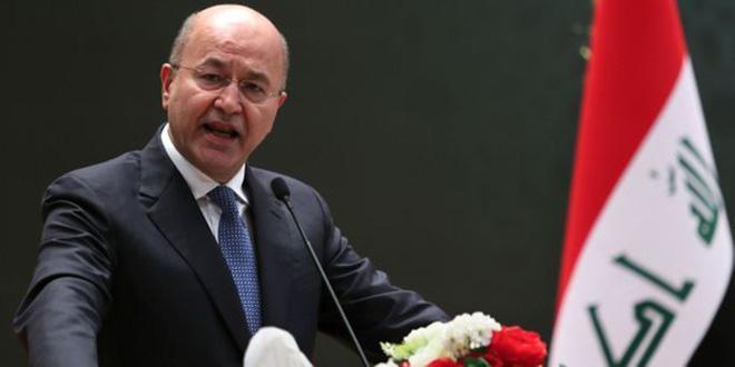 Irak: le président promet des élections